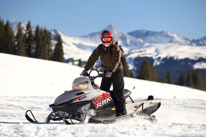 Alternative Activities Ski Holiday - Riding on a snowmobile